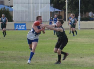 Caleb 'Skins' Dobos blocks a Tamworth handball