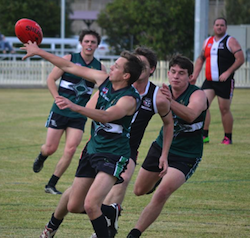 Shannon MacDonald tips the ball to advantage during the game at Inverell.