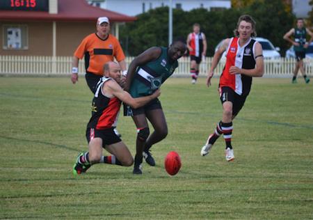 Velani Chakalisa getting tackled.