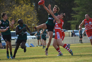 Tom Hunt winning a tap against the Swans.
