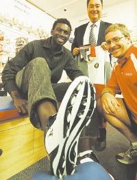 Omphile Temoso, NECU's Kevin Dupé and Paul Schmude of Sportspower