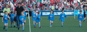 Armidale's Auskick participants at the Sydney Cricket Ground where they played during the half-time break in a Sydney Swans/West Coast Eagles match in July last year.