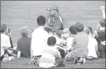 Craig Collins talks to some of the kids attending the weekend's Auskick training.