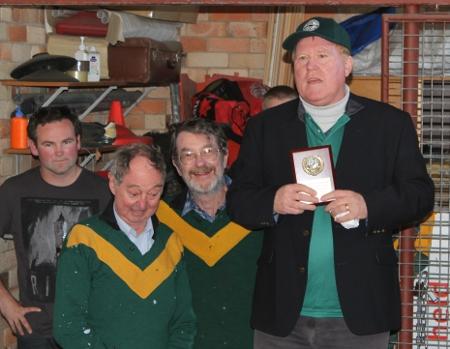 Rod Gillett calling Bob Cason and Teddy Edwards forward to present their trophy