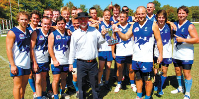 Winner of the Tablelands AFL Knockout, North Coffs Harbour with UNE Vice-Chancellor Jim Barber.