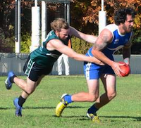 Hugh Cook tackling a Roo in round 1.