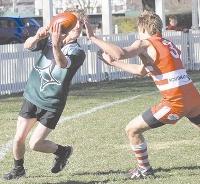 Clint Ballagh handballs inside