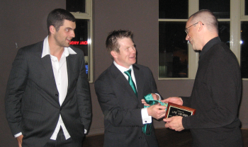 Ron Crump receiving his life-membership from Ben Page